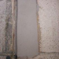 Grubopowłokowy materiał Belzona 4141 (Magma-Build) zastosowany na powierzchni pionowej