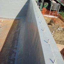 Odbudowany beton i zbiornik zabezpieczony przed przyszłymi uszkodzeniami z użyciem materiału Belzona 5811 (Immersion Grade)